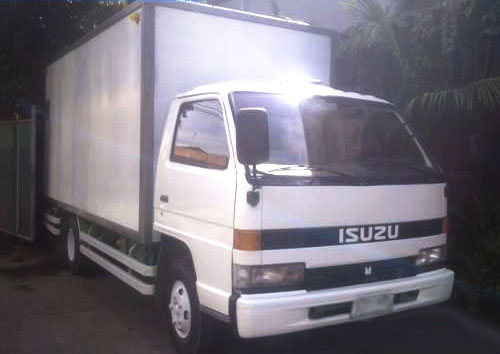 6 Wheeler Isuzu Forward Closed Van - Carry All Cargo Corp