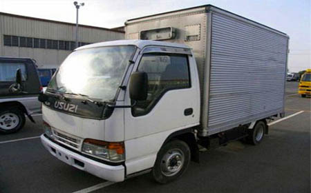 Isuzu Elf Closed Van - Carry All Cargo Corp